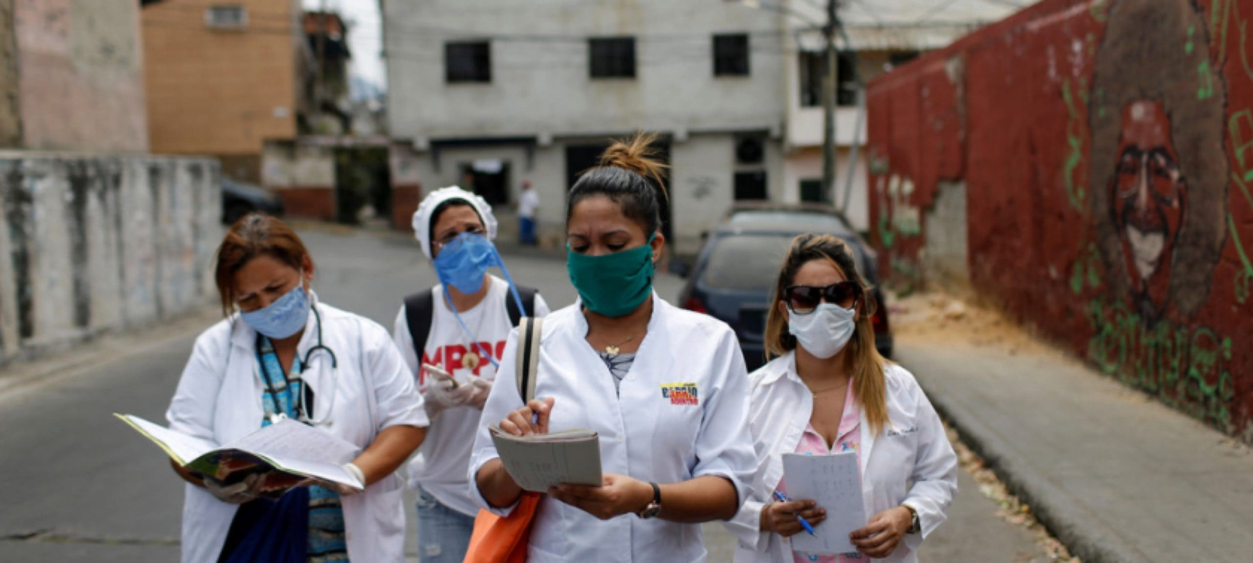 Cuban and Venezuelan healthcare workers carry out a COVID-19 inspection in a Caracas slum Image: REUTERS/Manaure Quintero